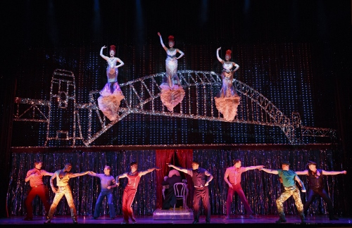 """Center left to right (flying): Emily Afton, Brit West and Bre Jackson and Company in the number """"It's Raining Men"""" © Joan Marcus"""