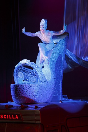 """Bryan West as Felicia atop """"Priscilla"""" (bus) in the number """"Sempre Libera"""" © Joan Marcus"""