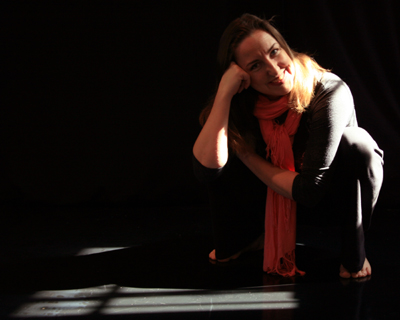 Director and choreographer, Sarah Morrison, reflects in her favorite sun spot in the MorrisonDance rehearsal studio located in the Ohio City neighborhood of Cleveland, OH.