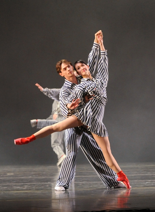 "PBT dancers Kumiko Tsuji & Luca Sbrizzi in Twyla Tharp's ""In the Upper Room"". Photo by Rich Sofranko."
